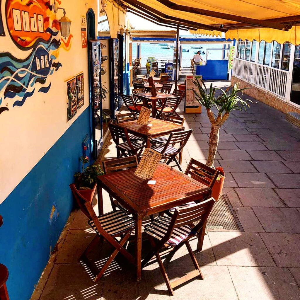 Outdoor seating with sea views in a bar in Corralejo in Fuerteventura